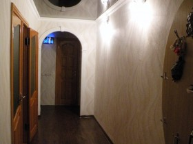 The interior is a long, dark hallway in the apartment