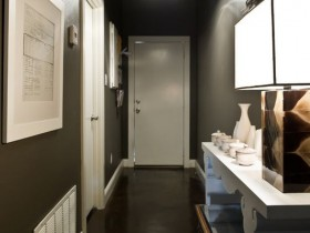 Dark hallway with white doors