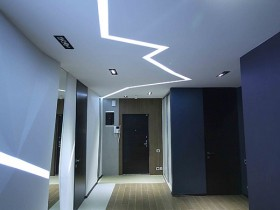 Contemporary blue hallway with creative lighting