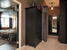 Dark hallway with black Cabinet