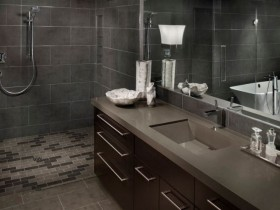 The combination of black with gray bathroom interior