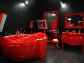The combination of dark red in the interior of the bathroom