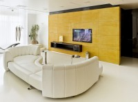 The unusual shape of the white sofa in the living room