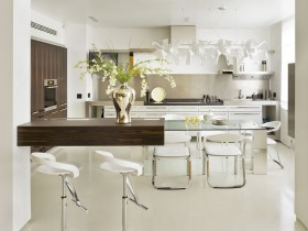 Spacious white kitchen with modern furniture