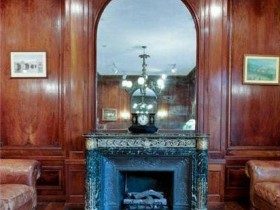 A fireplace in an English interior