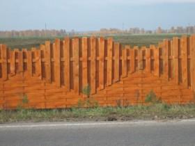 Деревянное ограждение участка