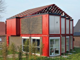 The finished facade of the house from containers