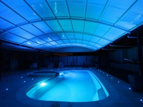 An indoor pool with lighting